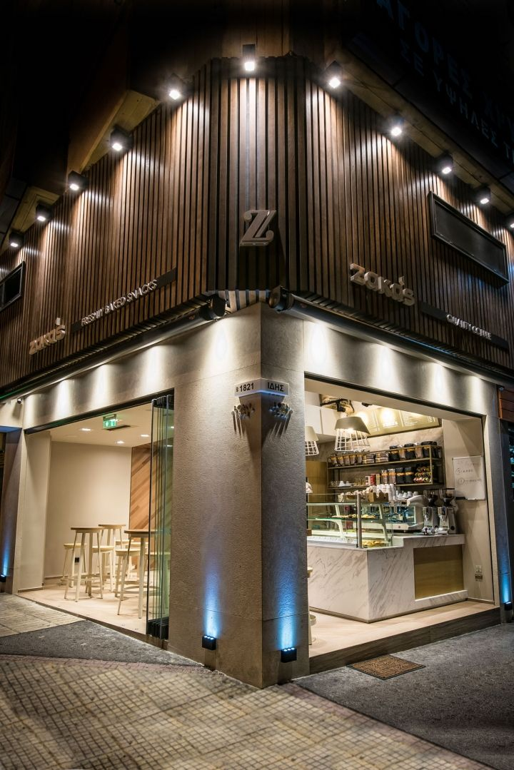 Very impressive  is the vertical construction of the wall inside the store, specially crafted oak by changing shades covers part of the wall surface. Highlight the facade of the store. Starts with alternately positioned wood and ends with Greek origin rock.