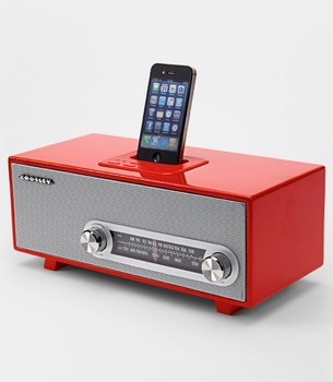 """Crosley Ranchero iPod Dock      Retro style meets modern music with the Crosley Ranchero iPod Dock. Inspired by the 1950s, this dock both charges and plays your iPod or iPhone and features an AM/FM radio. Pump up the volume or change the station using sleek silver chrome knobs. Analog tuner. Includes AC powder adapter. Measures 16.7""""x8.2""""x6.8"""""""