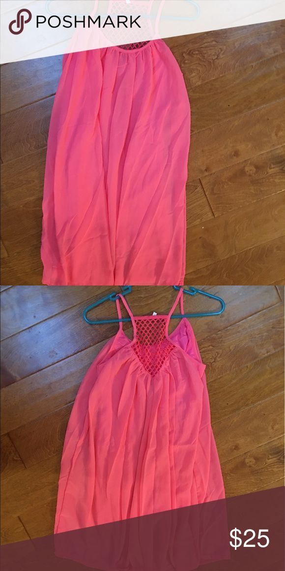 Bright neon pink sundress or coverup! Brand new! Bright neon pink sundress or bikini coverup. Could be used for either or for a day out with friends! It has a slip underneath so it's not see-through! It's really night & perfect for summer time! And it's a beautiful sundress!!  Size SMALL . Brand new! Never worn! No tags because I ordered online. But it is Brand new!! NWOT Dresses Midi