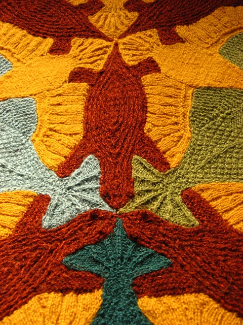 An absolutely amazing knitted Escher inspired blanket. It's a tessellation - http://science.howstuffworks.com/tessellations.htm.