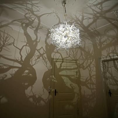 This has got to be the coolest chandelier ever. It turns your room into a forest!