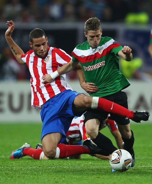 Mario Suarez (Atlético Madrid) tangles with Iker Muniain (Athletic Bilbao) during the UEFA Europa League Final between Atlético Madrid and Athletic Bilbao at the National Arena on 8 May 2012 in Bucharest, Romania.