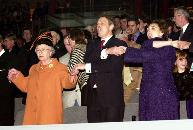 We don't look amused;  1 January 2000: The Queen joins Prime Minister Tony Blair and wife Cherie, in singing 'Auld Lang Syne' during midnight celebrations to welcome in the new year at the  Millennium Dome