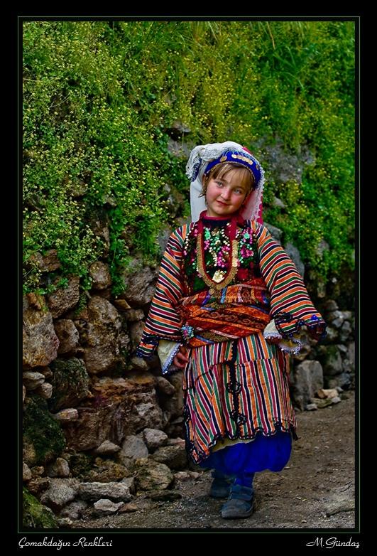 Little girl in traditional attire. In the village of Çomakdağ (district of Milas, Muğla province).