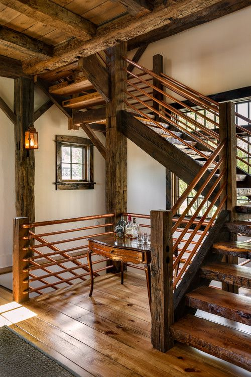 Beautiful wide plank hickory flooring in a stunning home designed by Crisp Architects with very custom copper and wood stairway.