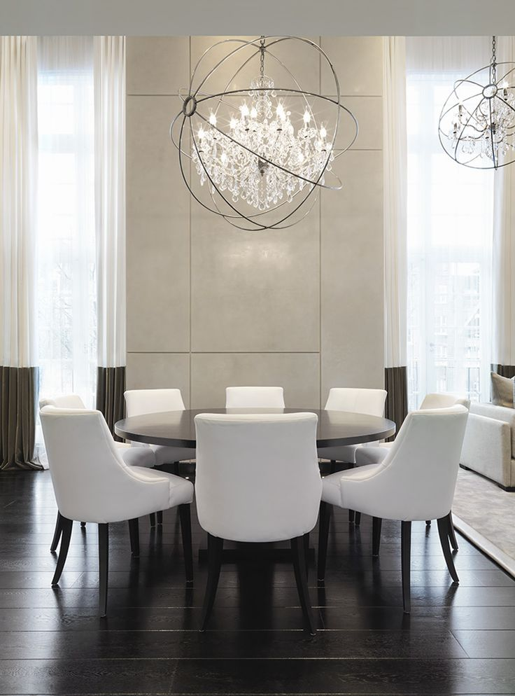 Formal white dining room | upholstered contemporary chairs | full length white curtains with deep taupe border and amazing chandelier|| Kelly Hoppen. London - Pied A Terre.