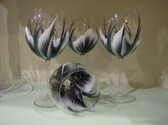 Hand painted Black wine glasses. Set of four sells for $40.