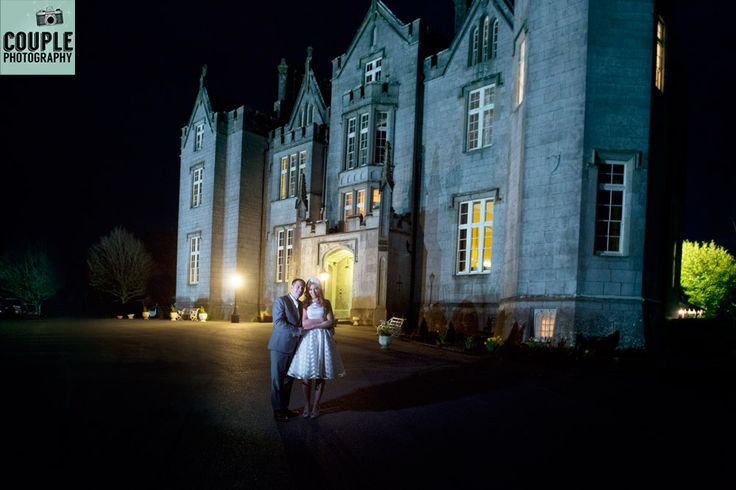 Epic photo of the Newlyweds in front of the castle at night. Photographed by a long exposure allowing the light to glow from the castle. Weddings at Kinnitty Castle photographed by Couple Photography.