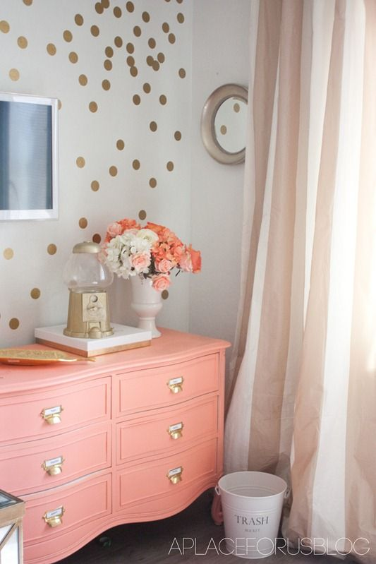 Coral and gold - love the dresser and the striped curtains!