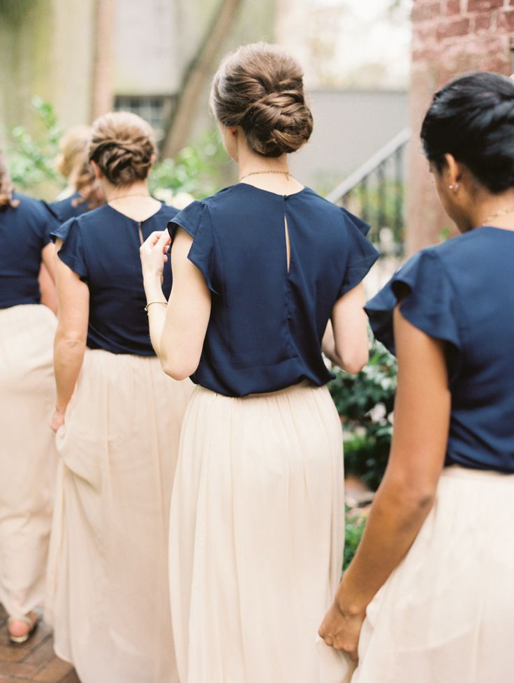 Bridesmaids in navy tops with long blush skirts | Photography: Sarah Kate