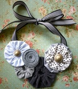 Necklace: use various sized yo-yo's and circle flowers in similar hues. Finish with a few buttons and gros grain ribbon.