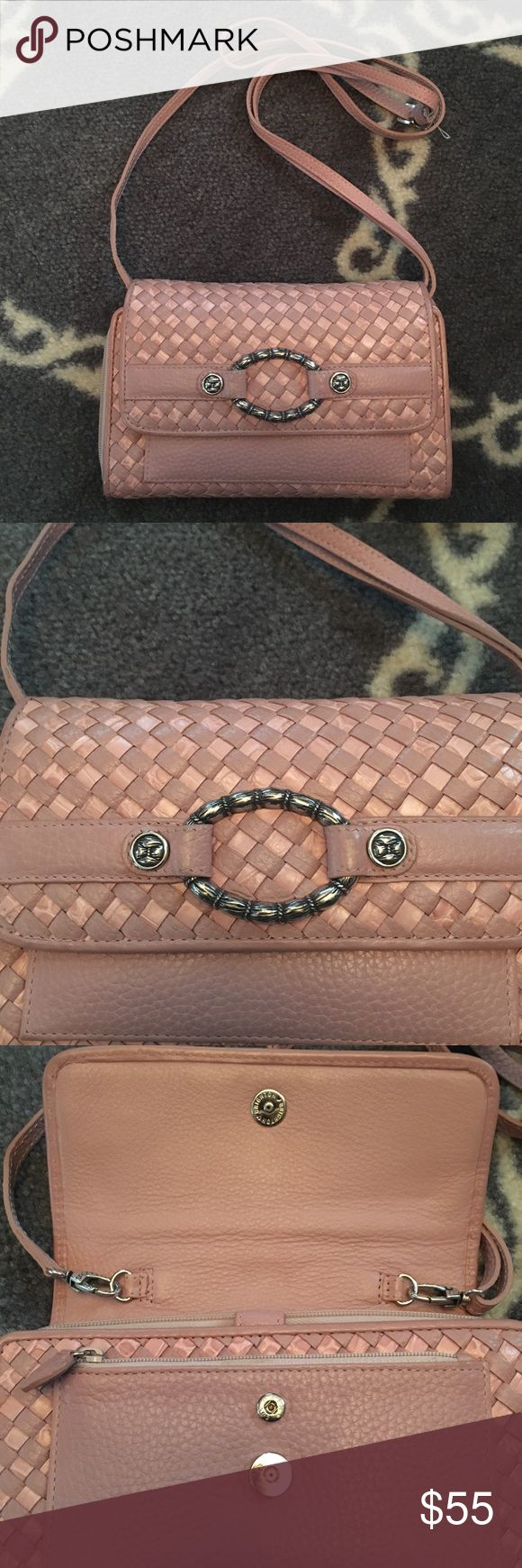 Brighton Woven Leather Crossbody Practically brand new Brighton leather woven Crossbody. It is a gorgeous bag!! Very light pink leather with tons of pockets. Magnetic snap closure. There is a space for checks, 6 credit cards slots, and an area for change and money. It also has a small zipper pocket on front of bag. Measurements are: 8 inches long and 5 inches high. Smoke free, pet friendly home. Brighton Bags Crossbody Bags
