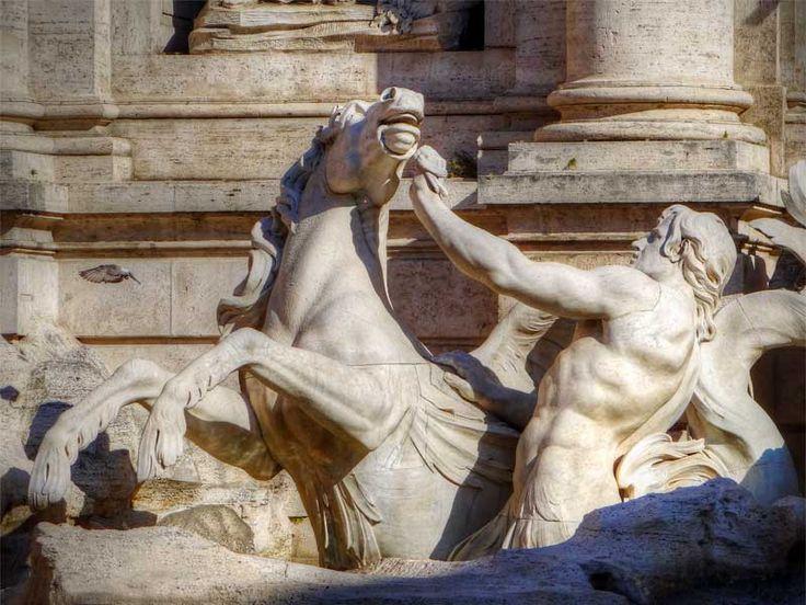 This Triton stuggles with a wild sea horse. Trevi Fountain, Italy.