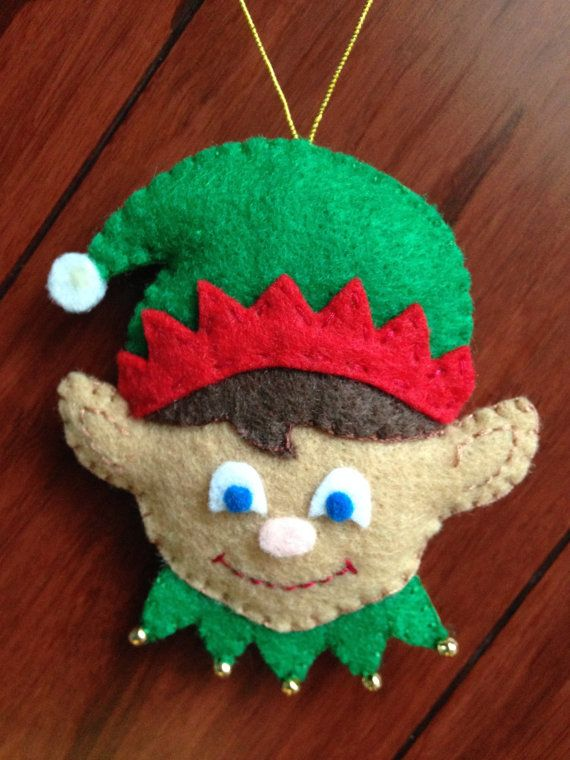This cute christmas elf would make a great christmas gift to anyone. It is dedicatedly hand made with lots of love and care!  Every piece is hand-cut (eco felt), hand embroidered or glued down using permanent craft bond (eyes and nose), lightly filled with hypo-allergenic polyester fiberfil and hand stitched. It includes a gold color code for hanging and gold color beads.  It approximately measures 3 1/4 x 2 3/4 (8cmx7cm). The gold code is 2 1/2 (6 1/2cm) long.  Please choose hair color and…
