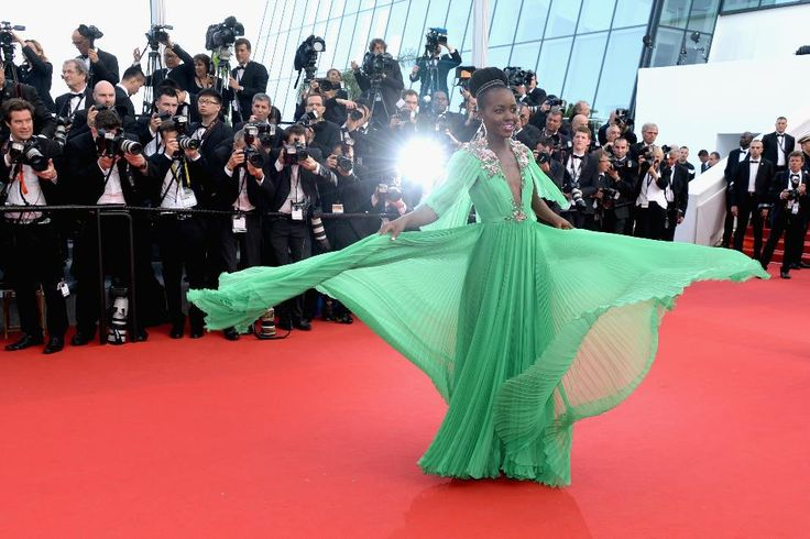 Lupita Nyong'o had yet another princess moment. Wearing a custom Gucci gown, she twirled the pleated skirt around to the delight of photographers.