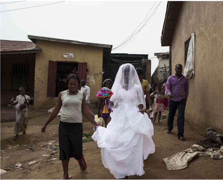 This photo, a part of Glenna Gordon's series 'Nigeria Ever After' makes comment on the deep contrasts of the lifestyle thats pictured throughout Nigeria and the western tradition of a wedding with a white gown and all. The pure white of the dress contrasted with the dark brown helps bring separation to the image
