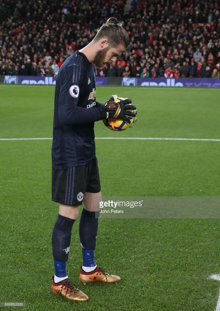 News Photo : David de Gea of Manchester United walks out ahead...