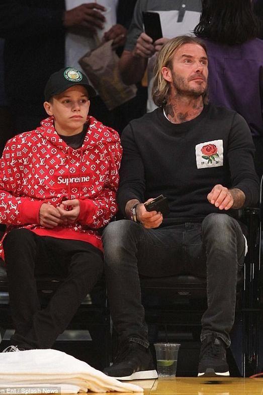 David Beckham wearing Adidas Iniki Runner in Core Black, Saint Laurent Skinny-Fit 15cm Hem Stretch-Denim Jeans in Black and Kent & Curwen Slim-Fit Rose Appliqued Loopback Cotton-Jersey Sweatshirt