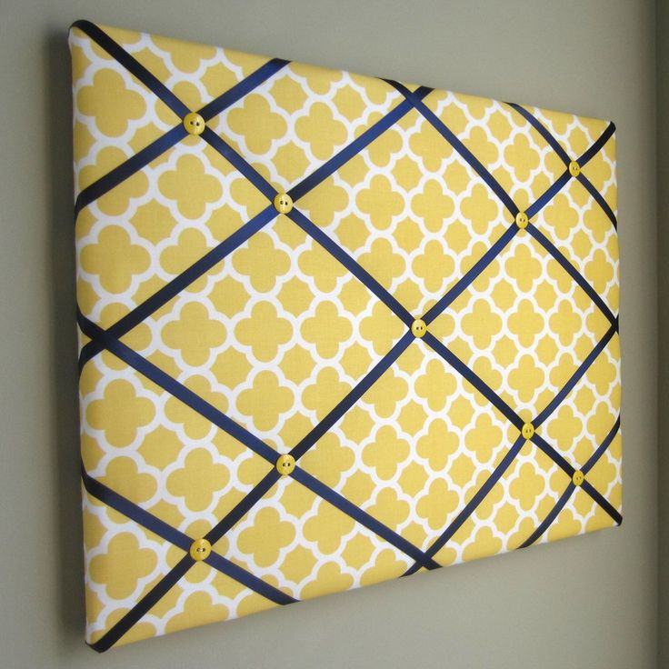 "This is a gorgeous 16""x20"" memory board, memo board, ribbon board, in a yellow and navy quatrefoil fabric. The memory board is accented with a navy satin ribbon and yellow buttons. Handmade fabric mem                                                                                                                                                                                 More"