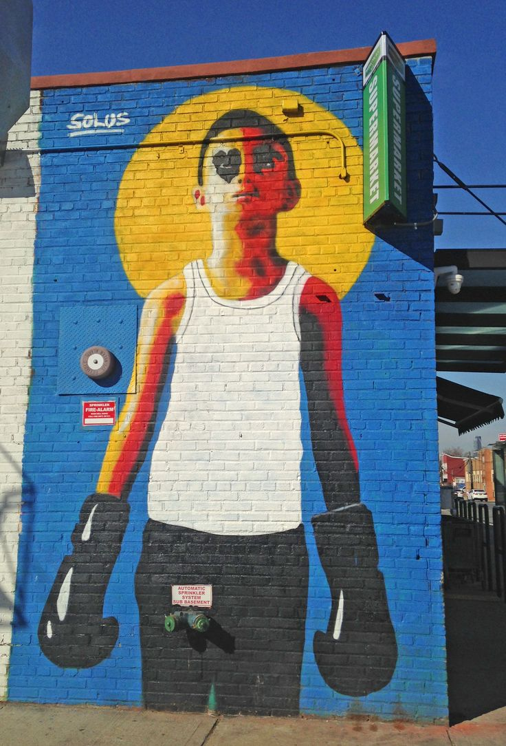 Artwork by Irish artist Solus. Street art work in Brooklyn, New York City. Graffiti is widespread - with many murals, wheatpastes and stencils.