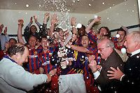 Dagenham players celebrate victory and reaching a Wembley final in the dresing room after the game - Dagenham & Redbridge vs Gloucester City - FA Challenge Trophy Semi-Final Replay at Slouth Town - 16/04/97 - MANDATORY CREDIT: Gavin Ellis/TGSPHOTO - Self billing applies where appropriate - 0845 094 6026 - contact@tgsphoto.co.uk - NO UNPAID USE..