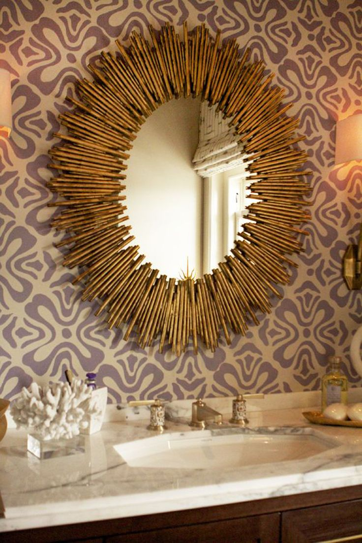 gold mirror, sunburst mirror, purple wallpaper, coral, sink styling, carrera marble countertops, walnut cabinets  Home decor trends. Covet Lounge inspirations.#curateddesign #interiors #homedecor #furniture #luxury #exclusive #covet #inspiration #bathroom