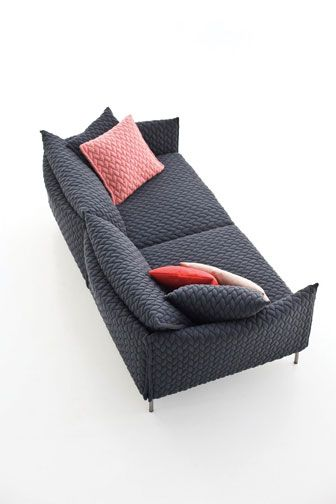 Patricia Urquiola's Gentry sofa with knitted upholstery, down cushions, and polyurethane foam over steel by Moroso