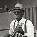"""John Adam """"Sleepy"""" Estes was a singer, guitarist, and songwriter who is considered to be one of the most important artists in blues history. Estes was born into a sharecropping family just outside of Ripley, Tennessee,John Adam """"Sleepy"""" Estes was a singer, guitarist, and songwriter who is considered to be one of the most important artists in blues history. Estes was born into a sharecropping family just outside of Ripley, Tennessee, but raised in Brownsville. He got his nickname """"Sleepy""""…"""