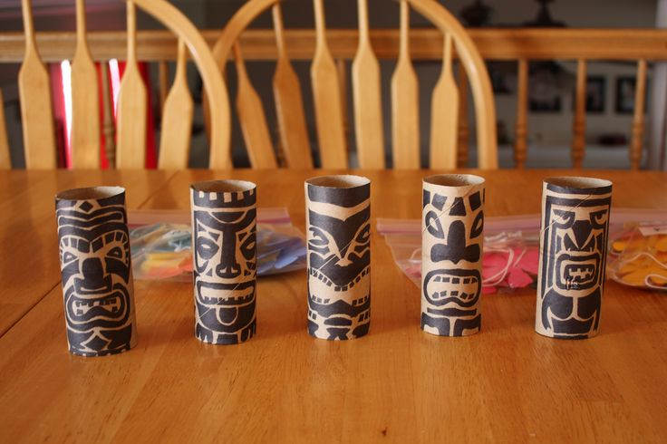 I saved up toilet paper rolls and paper towel rolls to make these fun tikis! I drew the image out with a sharpie. These were part of our centerpieces for our Blue and Gold Banquet/Luau! We put little tea lights in them!