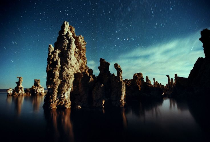 "Mono Lake, California       Known for its surreal ivory limestone structures called 'tufa towers,"" the lake's water is two and a half times saltier than the ocean. The eerie natural art installations were formed when the level of the lake water was higher and freshwater springs were flowing into it."