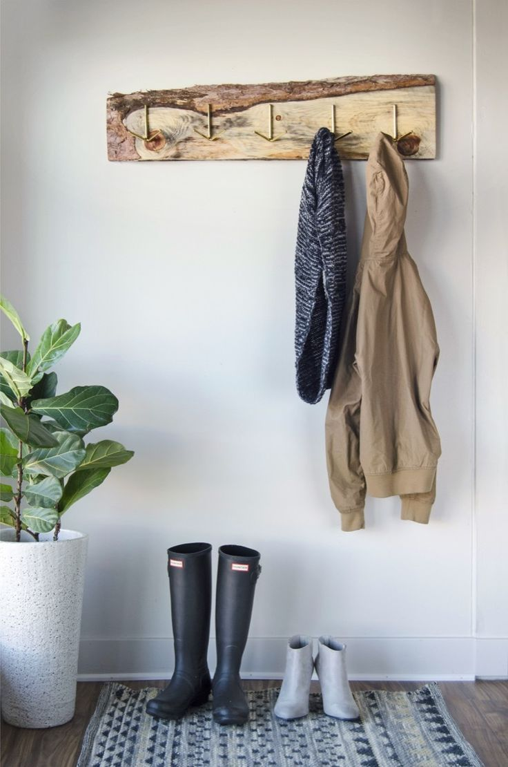 An old, discarded board gets new life as a rustic DIY coat rack. #sponsored @homedepot