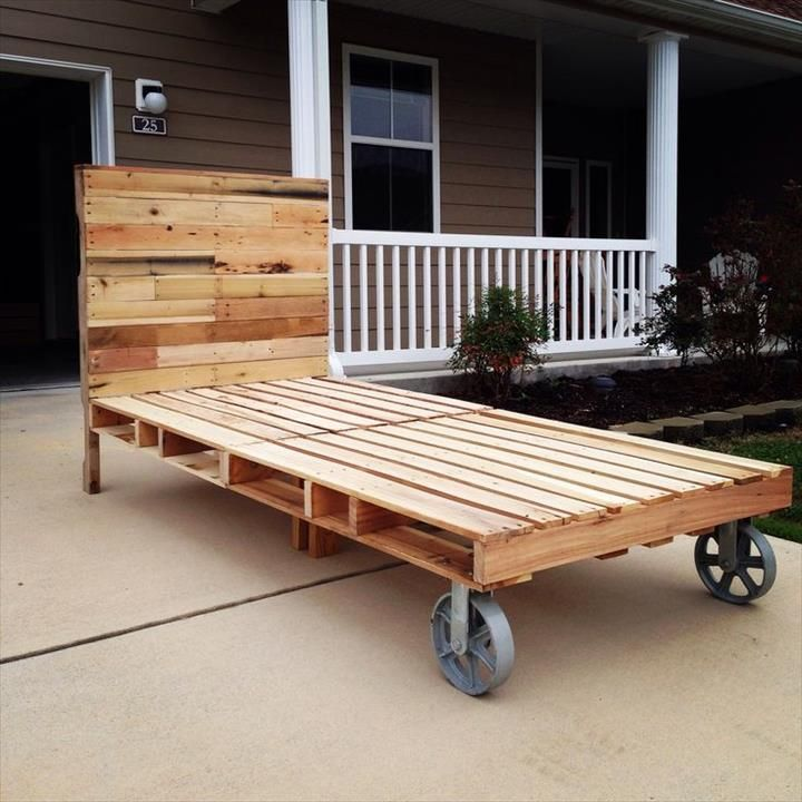 Pallet bed with cart wheels 42 diy recycled pallet bed for Recycled pallet bed frame