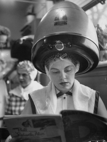 Woman Sitting under Hair Dryer Reading a Magazine Premium Photographic Print by Gordon Parks at Art.com