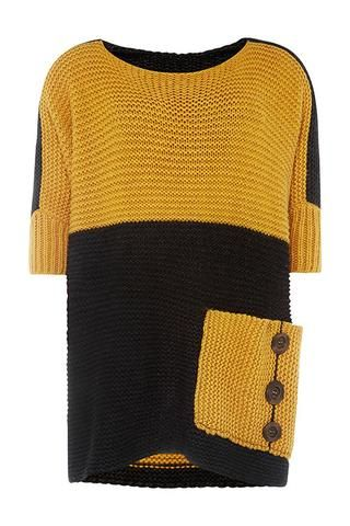 Super warm, oversized jumper inLambswool and Nylon blend. Patch pocket on front left with wooden button detail. Chunky but luxurious - you won't want to take it off all weekend!