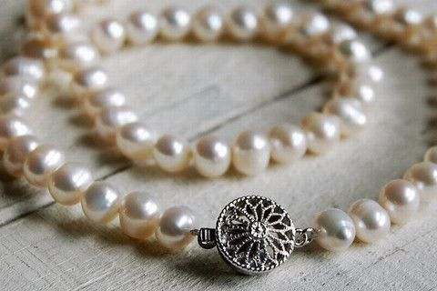 White pearl necklace with silver clasp