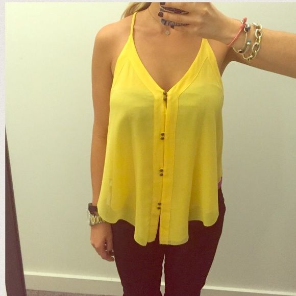 Dolce Vita Yellow Cami Tank. New without tags! Slightly longer in front than the back. Racer back... 100% polyester.. No trades Dolce Vita Tops Tank Tops