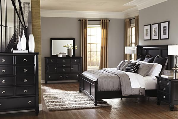 "The Greensburg Panel Bedroom Set from Ashley Furniture HomeStore (AFHS.com). The rich black paint finish beautifully embracing the warm cottage design of the ""Greensburg"" bedroom collection creates a relaxing atmosphere along with the function of the ample storage within the footboard and stylish case pieces making this the perfect addition to any bedroom décor."