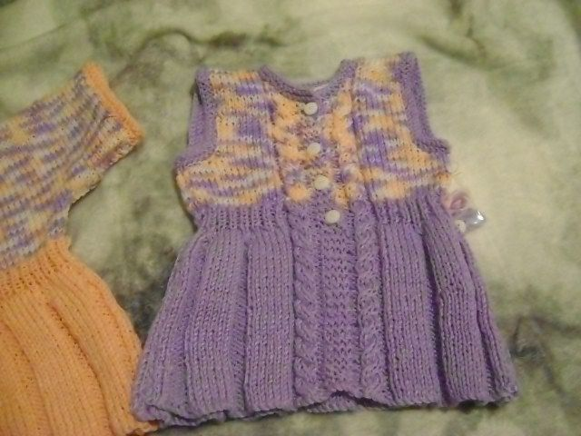 Baby girlls dress, with plaets and cables. This is an original design by me. 6-12 months Acrylic. Purple | Shop this product here: http://spreesy.com/LittleKiwiKnits/1 | Shop all of our products at http://spreesy.com/LittleKiwiKnits    | Pinterest selling powered by Spreesy.com