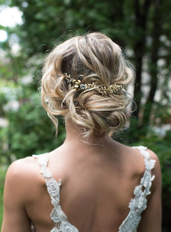 Messy has never looked this good. Flawlessly curled hair meets an entire bottle of hairspray for this fun and dramatic 'do. Add a statement piece to pull the look together (literally) and you have the most fab wedding hair. LottieDaDesigns via Etsy