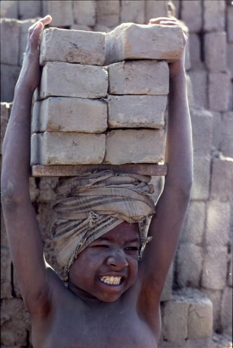 Children of the Dust. Lugging bricks, inhaling clay dust, India by Eric Valli…
