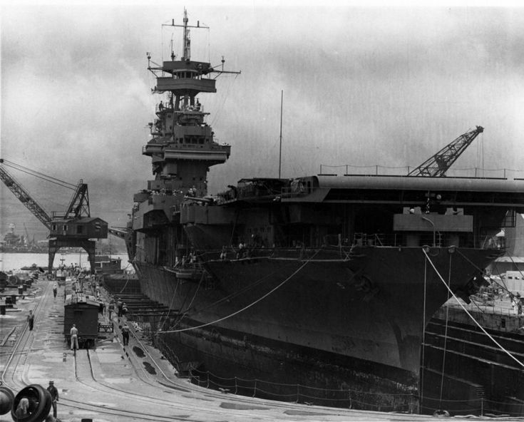 USS Yorktown (CV-5) in Dry Dock # 1 at the Pearl Harbor Navy Yard, May 29, 1942, receiving urgent repairs for damage received in the Battle of the Coral Sea. She left Pearl Harbor the next day to participate in the Battle of Midway. USS West Virginia (BB-48), sunk in the Dec. 7, 1941 Japanese air attack, is being salvaged in the left distance. Official U.S. Navy Photograph, now in the collections of the National Archives.