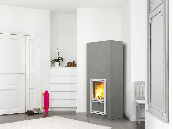 Nuuta heat-retaining corner fireplace with full-sized tiles in sink grey. www.tulikivi.fi