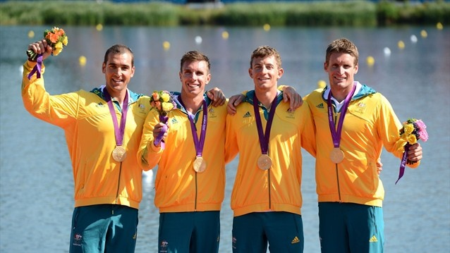 Australia celebrate winning the gold in the men's Kayak Four (K4) 1000m Canoe Sprint Tate Smith, Dave Smith, Murray Stewart, and Jacob Clear (L-R) of Australia celebrate winning the gold medal during the medal ceremony for the men's Kayak Four (K4) 1000m Canoe Sprint on Day 13 of the London 2012 Olympic Games at Eton Dorney.  (aug 9, 2012)