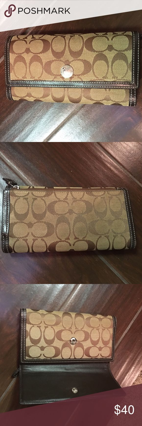 Coach wallet brown with dark brown leather trim Coach wallet. Originally a checkbook wallet but the check book is missing. Exterior shows wear but leather inside is still in great condition. I have not tried cleaning it. Coach Bags Wallets
