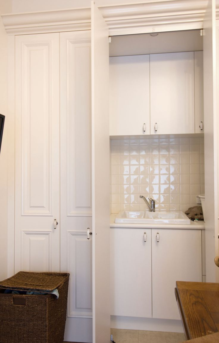 European laundry with traditional style doors. www.thekitchendesigncentre.com.au