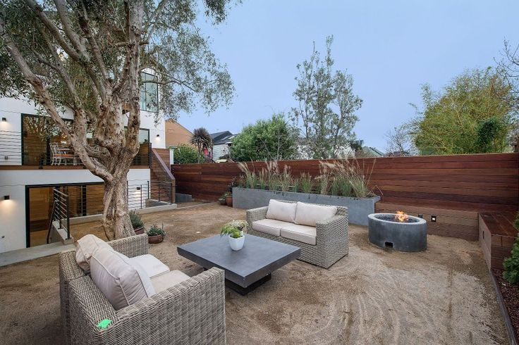 The south-facing yard offers a gas fire pit, modern planter boxes and low-maintenance landscaping. Photo: Open Homes Photography