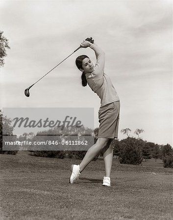 1960s WOMAN PLAYING GOLF TEEING OFF GOLF BALL FROM TEE WITH DRIVER SUMMER OUTDOOR  – Image © ClassicStock / Masterfile.com: Creative Stock Photos, Vectors and Illustrations for Web, Mobile and Print