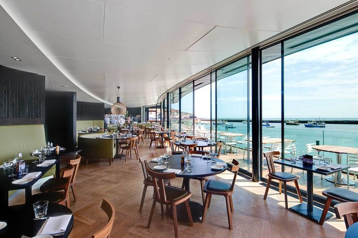Floor to ceiling windows flood the restaurant with light