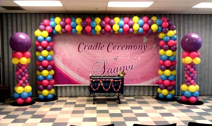 Cradle arch banner columns 700 419 naming for Baby name ceremony decoration