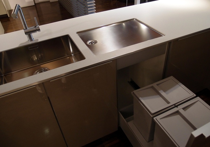 A crisp/tailored undermount sink and separate drainboard by Blanco.
